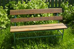 Stock Photo of brown bench with nobody in the park