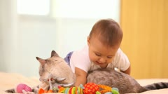Baby with cat Stock Footage