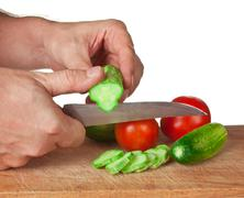 Chop tomatoes and cucumbers Stock Photos