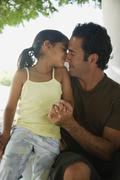 Stock Photo of Hispanic father and daughter hugging