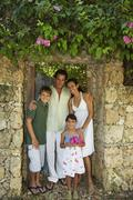 Hispanic family in garden doorway Stock Photos