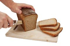 Hand cut rye bread on a board Stock Photos