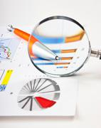 Stock Photo of magnifying glass and the working paper