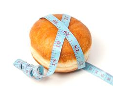Bun for the hamburger with tape measure Stock Photos