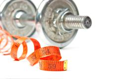 Dumbbell and measuring tape Stock Photos