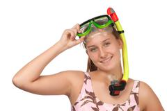 Young girl with a mask for diving Stock Photos