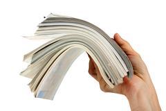 magazine in hand - stock photo