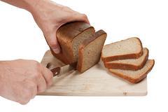 Stock Photo of hand cut rye bread on a board