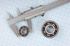 Stock Photo of technical drawing and callipers with  bearing