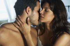 Hispanic couple hugging Stock Photos