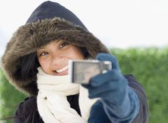 Pacific Islander woman taking own photograph - stock photo