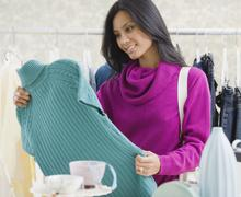 Pacific Islander woman clothing shopping - stock photo