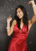 Pacific Islander woman in evening gown dancing - stock photo