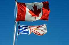 canadian & newfoundland flags - stock photo