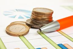 coinss and the working paper - stock photo