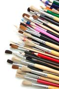 Colored pencils and  brushes Stock Photos