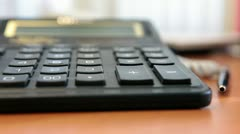 Pushing buttons on calculator by finger Stock Footage