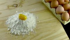 Stock Video Footage of egg dropping into flour