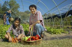 Multi-ethnic father and daughter with organic produce - stock photo