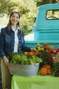 Middle Eastern women at organic farm stand Stock Photos