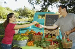 Hispanic couple at organic farm stand Stock Photos