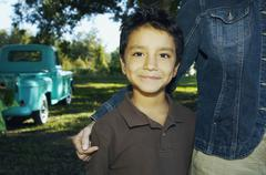 Hispanic boy with truck in background Stock Photos