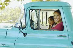 Hispanic mother and daughter driving truck Stock Photos
