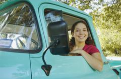 Hispanic woman sitting in truck Stock Photos