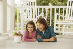 Hispanic mother and daughter coloring Stock Photos