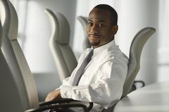 African American businessman sitting in chair Stock Photos