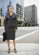 Asian businesswoman in urban area - stock photo