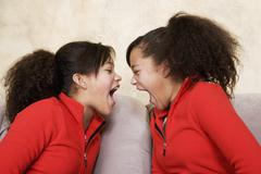 African twin sisters yelling Stock Photos