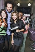 Multi-ethnic hair stylists in salon Stock Photos