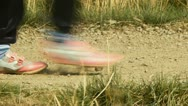 Close up view of riders and horses legs in terrain Stock Footage