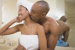 African couple hugging in bathroom Stock Photos