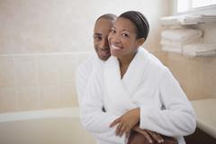 Stock Photo of African couple in bathrobes hugging
