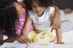 African mother reading to daughter Stock Photos