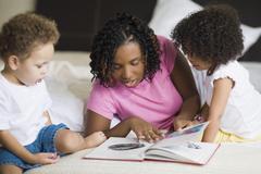 African mother reading to children Stock Photos