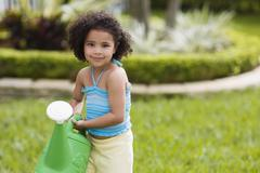 African girl holding watering can Stock Photos