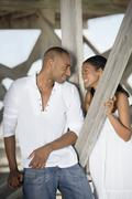 Multi-ethnic couple smiling at each other Stock Photos