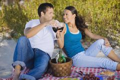 Hispanic couple having picnic Stock Photos