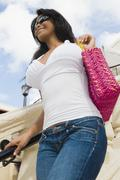 Stock Photo of Hispanic woman holding purse