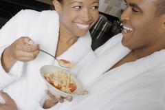 African couple eating breakfast Stock Photos