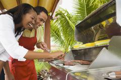 Stock Photo of Multi-ethnic couple barbecuing