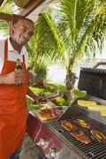 African man barbecuing Stock Photos