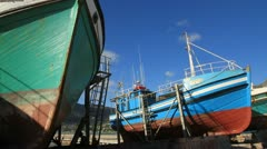 Fishing boats in dry dock Stock Footage