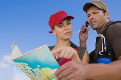 Hispanic couple looking at map Stock Photos