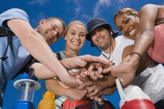 Multi-ethnic friends in huddle - stock photo