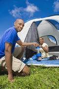 African couple camping Stock Photos