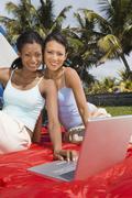Stock Photo of Hispanic women next to laptop